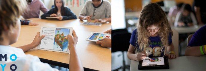 ребенок школьник занимается на планшете