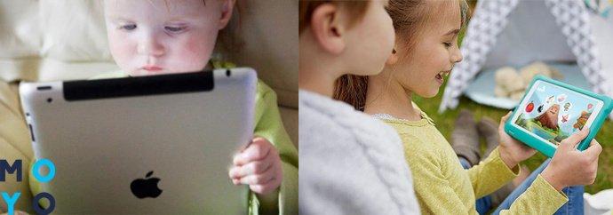 дети играют на планшете на природе